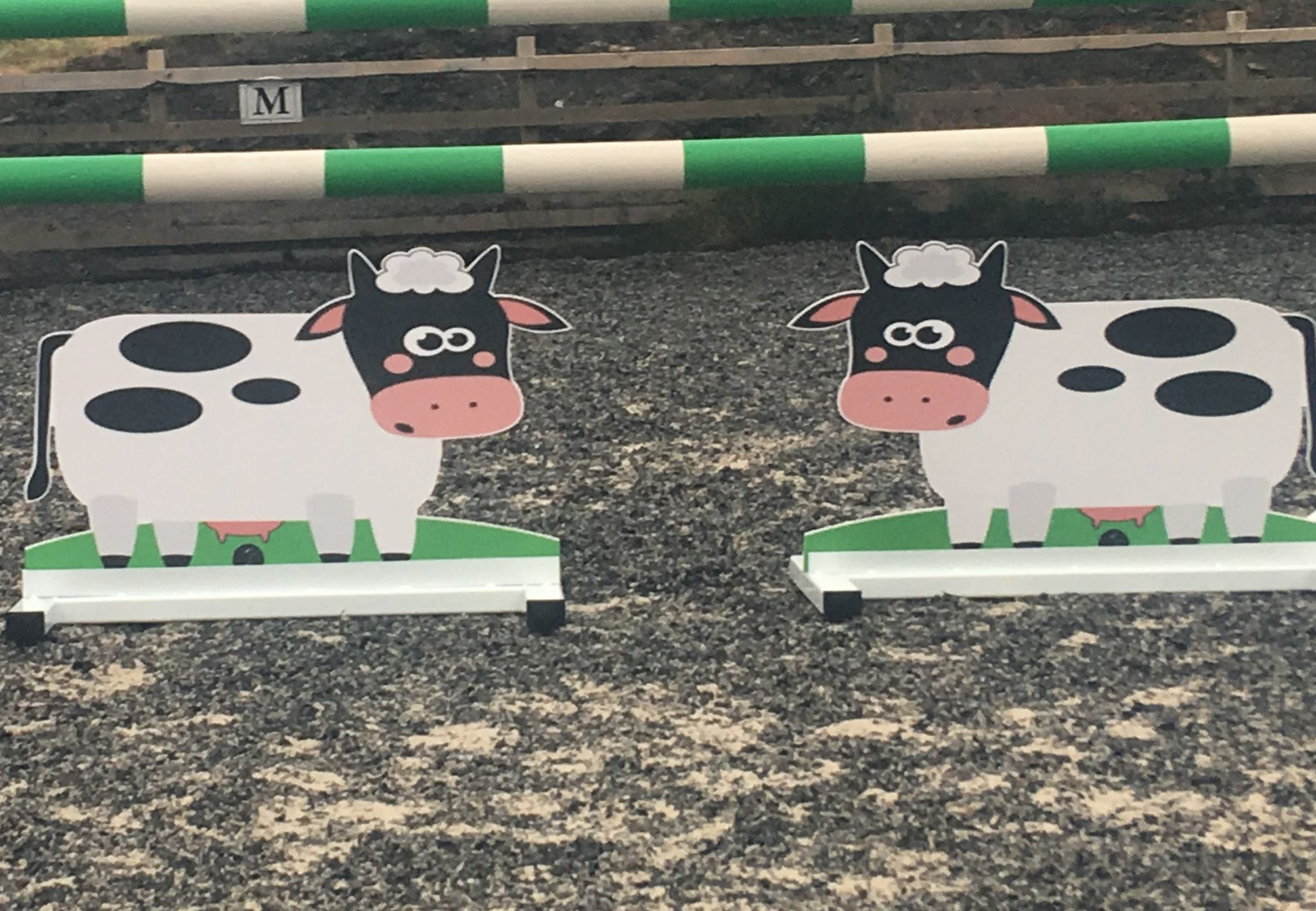 A Pair Of Free Standing Cow Fillers
